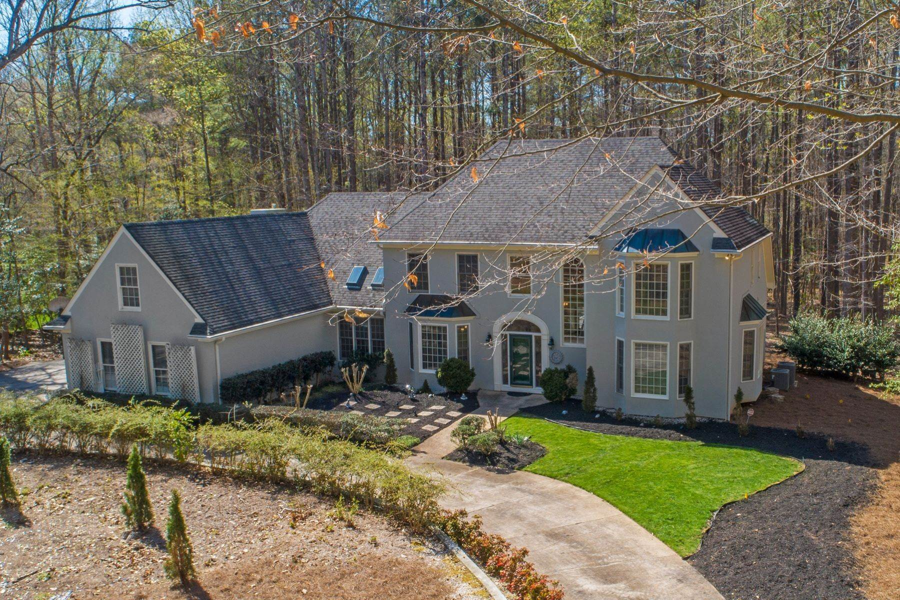 Single Family Homes for Sale at An alluring abode on an expansive lot, tucked within a prestigious subdivision 9709 Pentland Road Raleigh, North Carolina 27614 United States