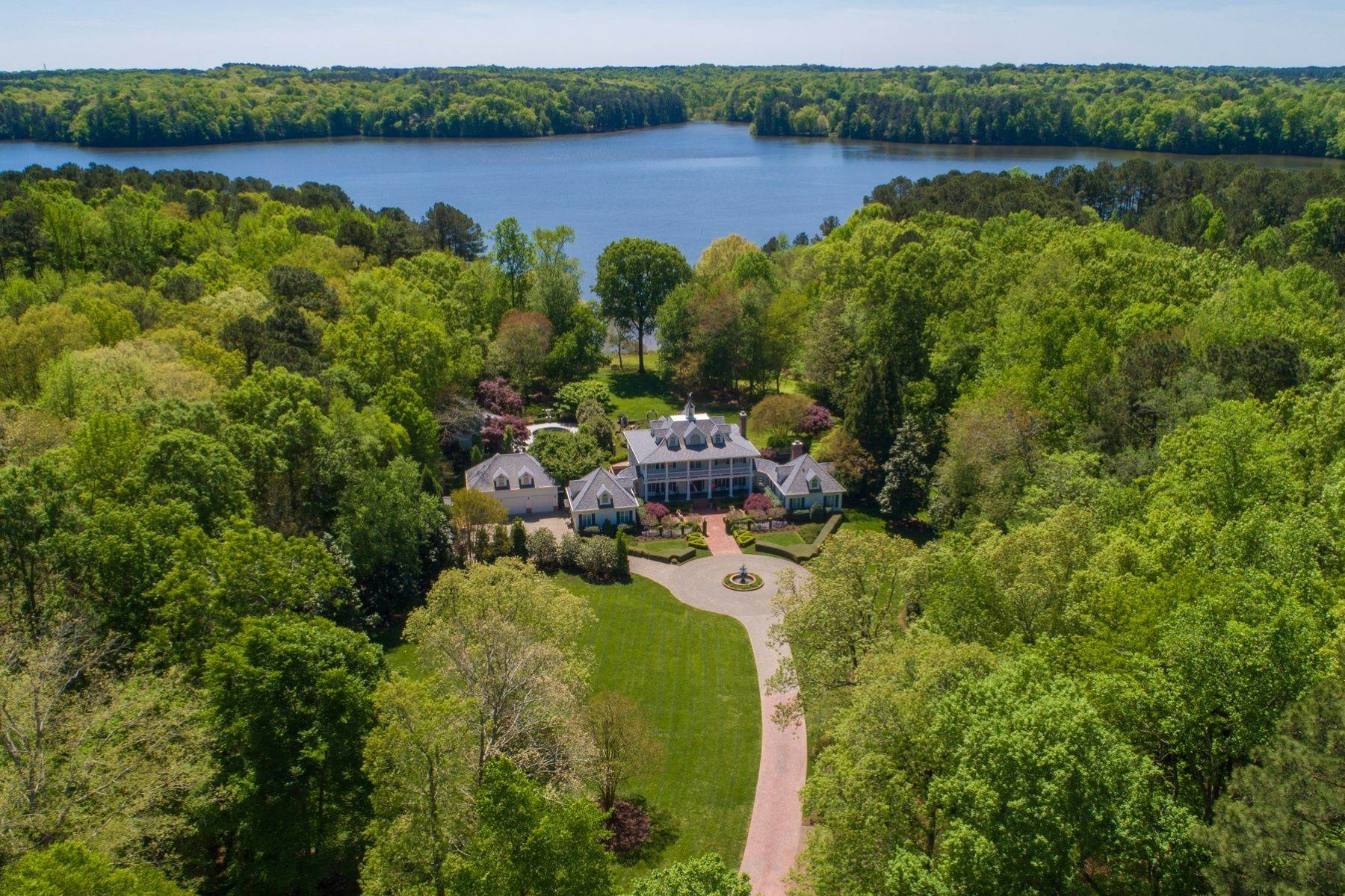 Single Family Homes for Sale at Lakefront Country Estate on Six Acres Minutes From Downtown Raleigh 5320 Burning Oak Court Raleigh, North Carolina 27606 United States